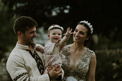 Alex, Lauren and Mars Melnik share an intimate moment at their wedding wearing traditional medieval clothing for their medieval themed wedding featured on the Henkaa infinity dress blog.