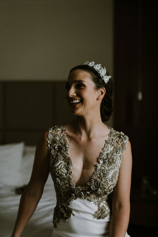 Bride with crown laughing in ornate wedding dress featured on Henkaa A Brides Story: Lauren & Alex on the Henkaa infinity dress blog.