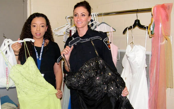 From left to right, volunteer Savannah White and DRPS officer Erin McConnachie show off some of the wares during Gowns for Girls. (Photo by Aly Beach