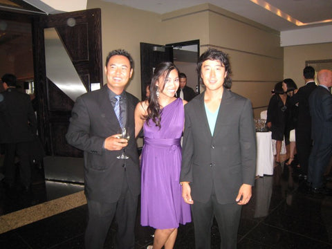 Joanna Duong Chang in Henkaa's first Plum Purple Sakura Midi Convertible Dress standing with two male wedding guests at Sonia's wedding.