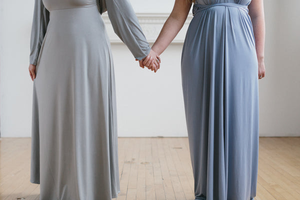 Bridesmaids holding hands wearing Henkaa convertible dresses - a must-have on your bridal checklist