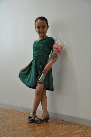 Little girl wearing the Sakura mini wrap dress in emerald green.
