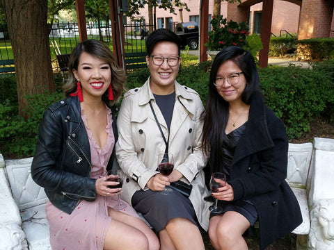 Older sister Sylvia Wong left, younger sister Caitlyn Wong middle, and Samantha Wong right sit together.