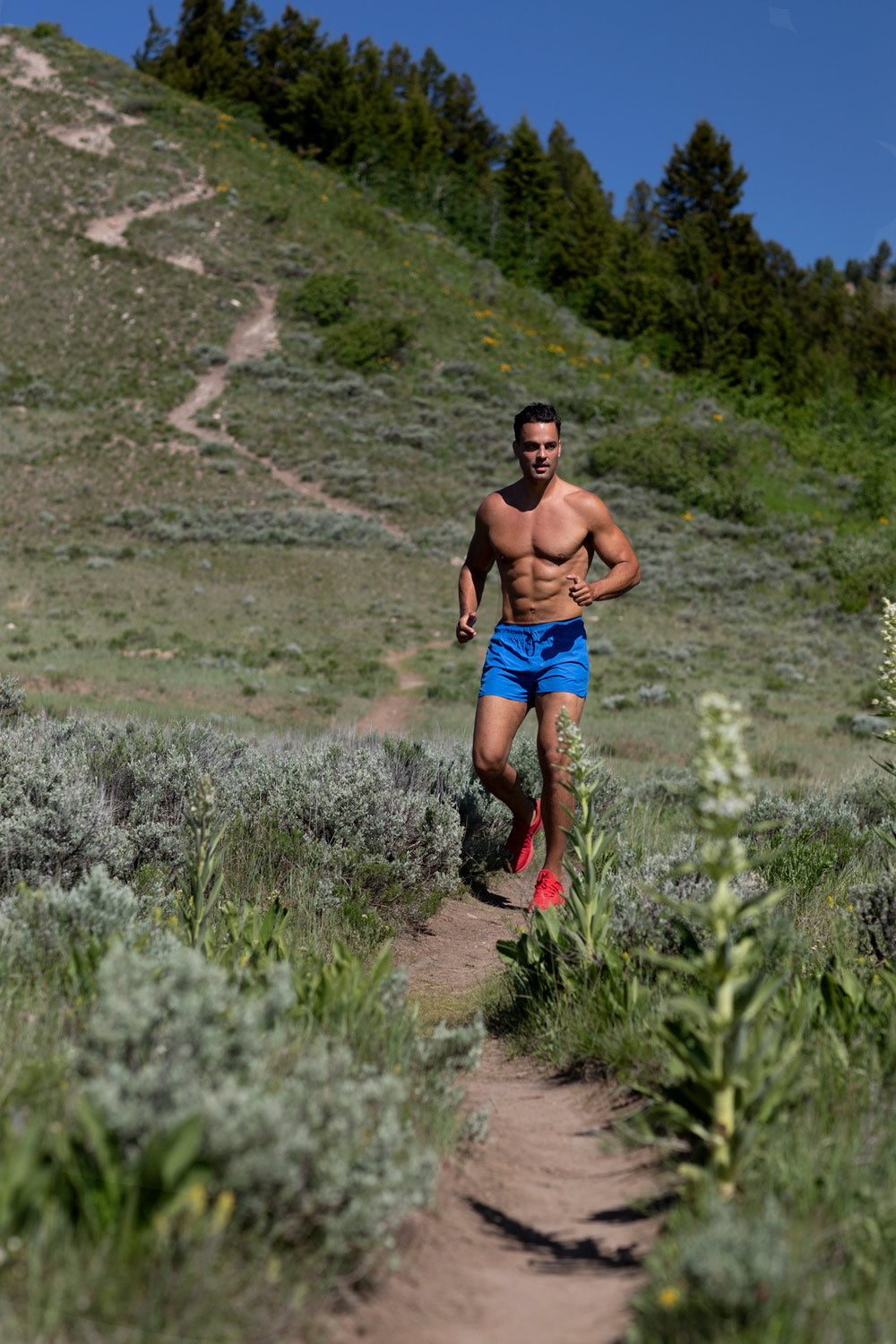Matthew Konsmo trail running on mountain trail