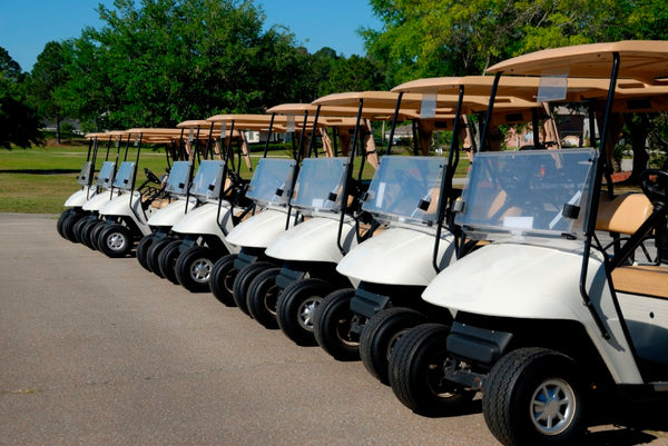 golf carts lined up for tournament