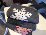 SkiBums bum warmers with snow flake design comes in three colors, white pink and charcoal snowflake.