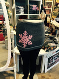 SkiBums bum warmer in charcoal with pink snow flake design.