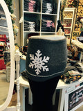SkiBums bum warmer in charcoal with white snow flake design.