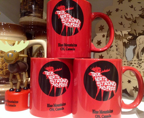 "Red Mug with Moose silhouette inscribed ""True North Strong and Free, Blue Mountains Ontario"""