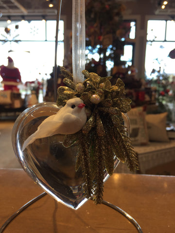 Heart shaped crystal christmas ornament with small greenery bouquet and white dove.  Fabric ribbon as a hanger.