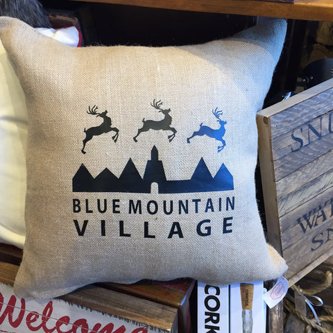 Sand Colored Burlap pillow with custom imprint of the Blue Mountain Village logo with reindeers.