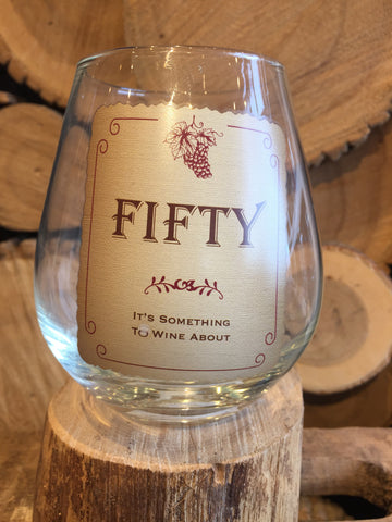 "This Stemless Wine Glass inscribed with ""FIFTY - It's Something To Wine About"""