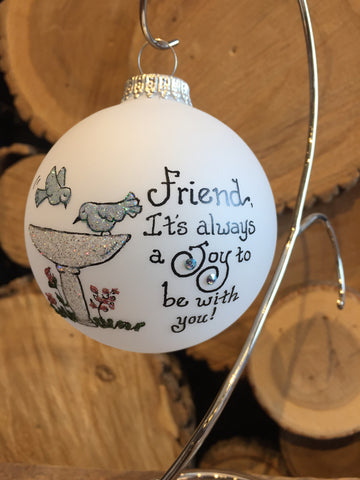 "White Frosted Round Ornament depicting a bird bath feature with inscription ""Friend, It's always a Joy to be with You"" painted in Swarovski Crystals"