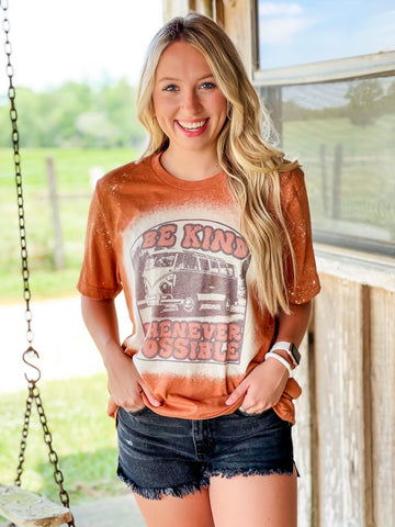 model posing in a be kind whenever possible graphic t-shirt