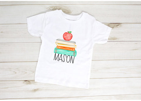 White kids t shirt with apple and books and the name Mason