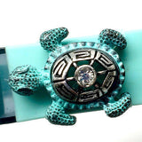 Closeup of Fitband Bling Sea Turtle two-tone silver and verdigris metal and rhinestone charm on Fitbit Flex band