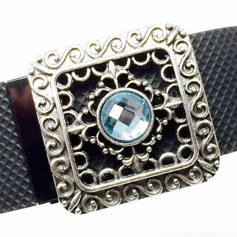 Details of Fitband Bling silver filigree with blue rhinestone center fitness band charm worn on a Fitbit Charge