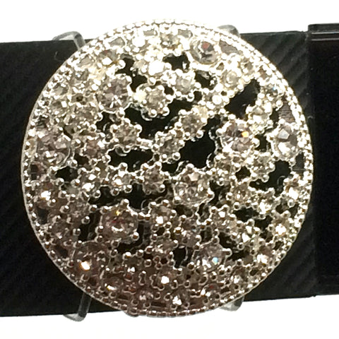 Closeup of sparkly rhinestone and silver fitness band accessory on a Fitbit Charge HR