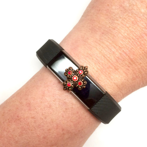 Fitness band cross charm with red rhinestones on a Fitbit Alta
