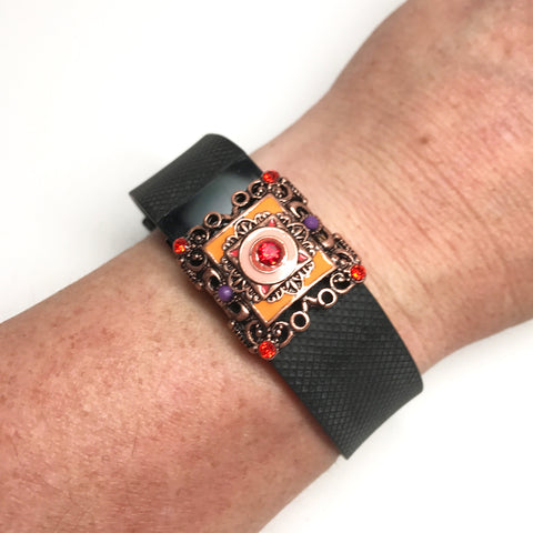 Fitband Bling Dawn Carnival with pink and orange enamel and orange rhinestones on a Fitbit Charge activity band