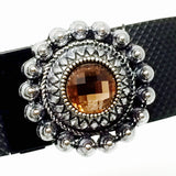 Closeup of Fitband Bling silver setting charm with amber center.