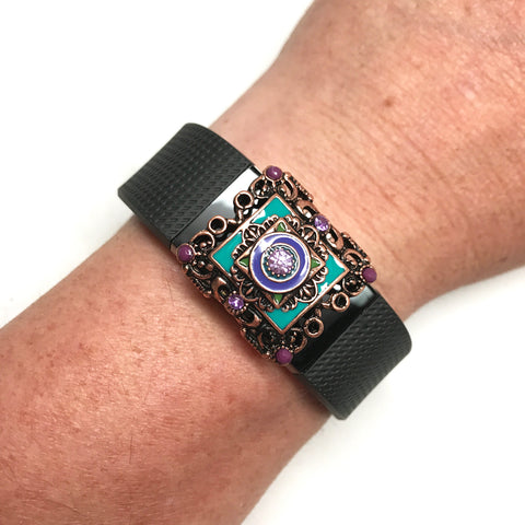 Fitband Bling Dusk Carnival with teal and purple enamel and lavender rhinestones on a Fitbit Charge 2 activity tracker band