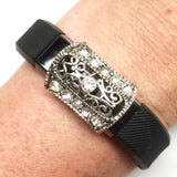 Antique silver half-barrel charm with clear rhinestones on Fitbit Alta