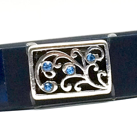 Closeup of Fitband Bling Brighton inspired Flirt fitness band accessory with blue rhinestones