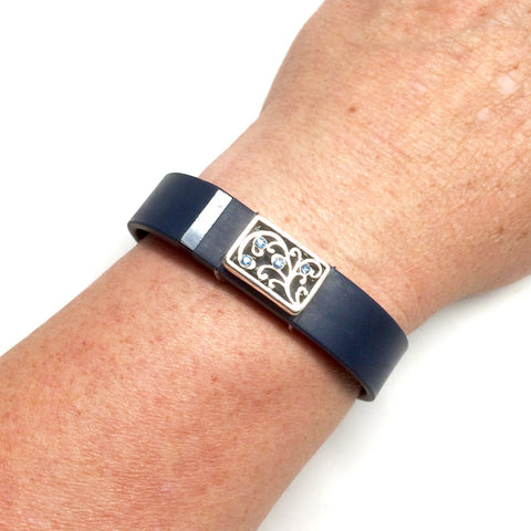 Silver plated charm swirl design with blue rhinestones on Fitbit Flex band