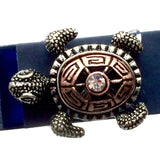 Closeup of Fitband Bling Sea Turtle two-tone copper and silver metal and rhinestone charm on Fitbit Flex band