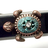 Closeup of Fitband Bling Sea Turtle two-tone verdigris and copper metal and rhinestone charm on Fitbit Alta band