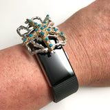 Sliding Fitband Bling gold Starfish embedded with turquoise rhinestones on silver coral setting shown on a Fitbit Charge 2 fitness tracker band