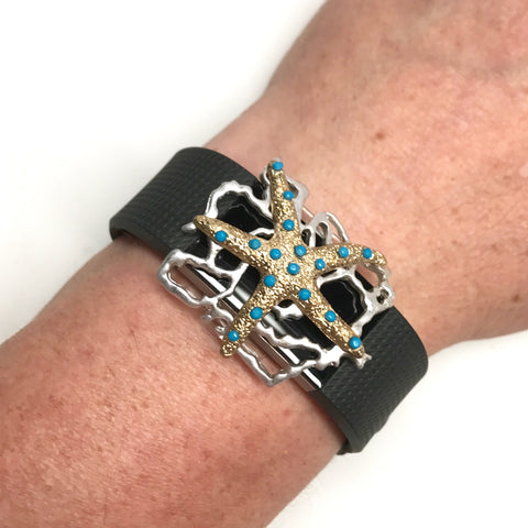 Fitband Bling gold Starfish embedded with turquoise rhinestones on silver coral setting shown on a Fitbit Charge 2 fitness tracker band