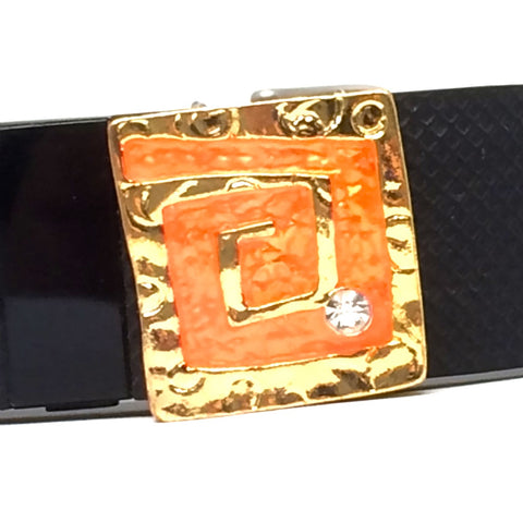Closeup of Fitband Bling sunrise fitness band accessory gold and orange greek key with rhinestone