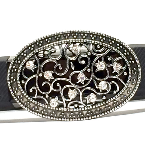 Closeup of large oval antique silver filigree setting with multiple clear rhinestones Fitband Bling fitness band charm accessory on Fitbit Alta
