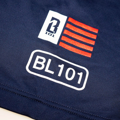 Close up of American flag logo and BL101 logo on navy short sleeve youth hoodie
