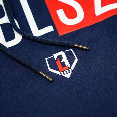 Close up of BL101 logo under BSBL SZN logo on youth short sleeve navy hoodie