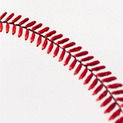 Close up of red baseball seams on white leather wallet