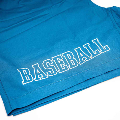 Closeup of BASEBALL graphic on blue shorts