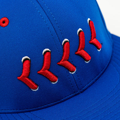 Close up of red stitching on blue fitted hat