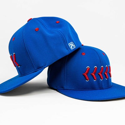 Side View Blue fitted hat with red baseball stitching