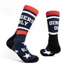 Navy socks with white stars on sole and DINGERS ONLY graphic around ankle