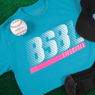 Bright blue t-shirt with BSBL written on front with baseball in image