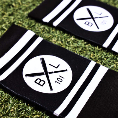 close up of white circle logo on black socks