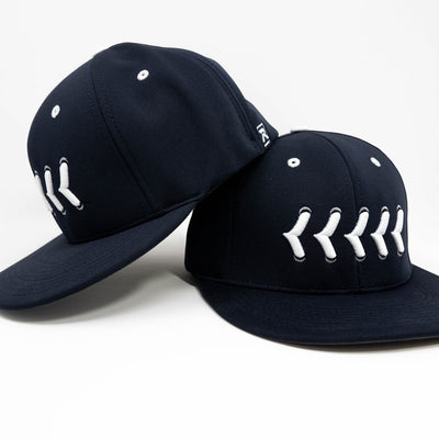 Navy fitted hat with white stitching front and side view