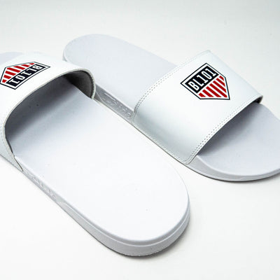 Front and back view of white slides with BL101 home plate flag logo across top