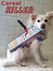 Little white dog wearing cereal killer Halloween costume