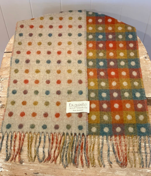 Exquisite reversible multi spot 100% merino wool scarf. Beige