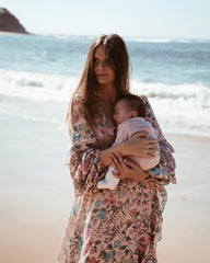 tuula vintage's jessica stein holding her baby on the beach