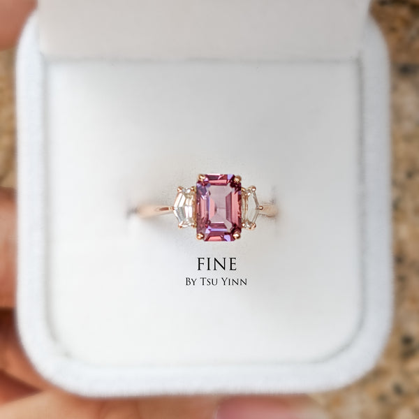 Pink spinel flanked between white sapphires